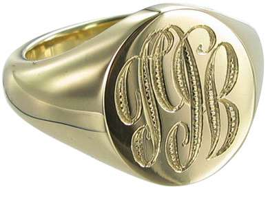 Gold Oval Signet Ring Engraved with a Monogram
